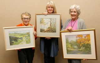 Val Shepherd, Sue Breirley and Maureen Waddington with their paintings